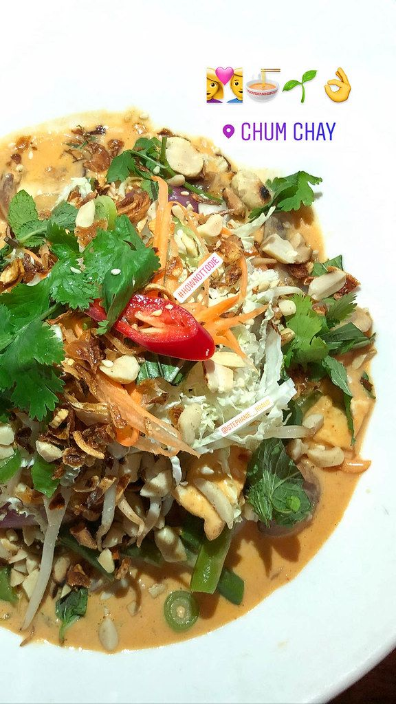 Vegan food at Chum Chay in Cologne - organic tofu in red coconut curry with beans, carrots, chestnuts, onions, mushrooms, shiitake mushrooms on fragrant rice, served with fresh soy germs, exotic herbs, peanuts and fried onions