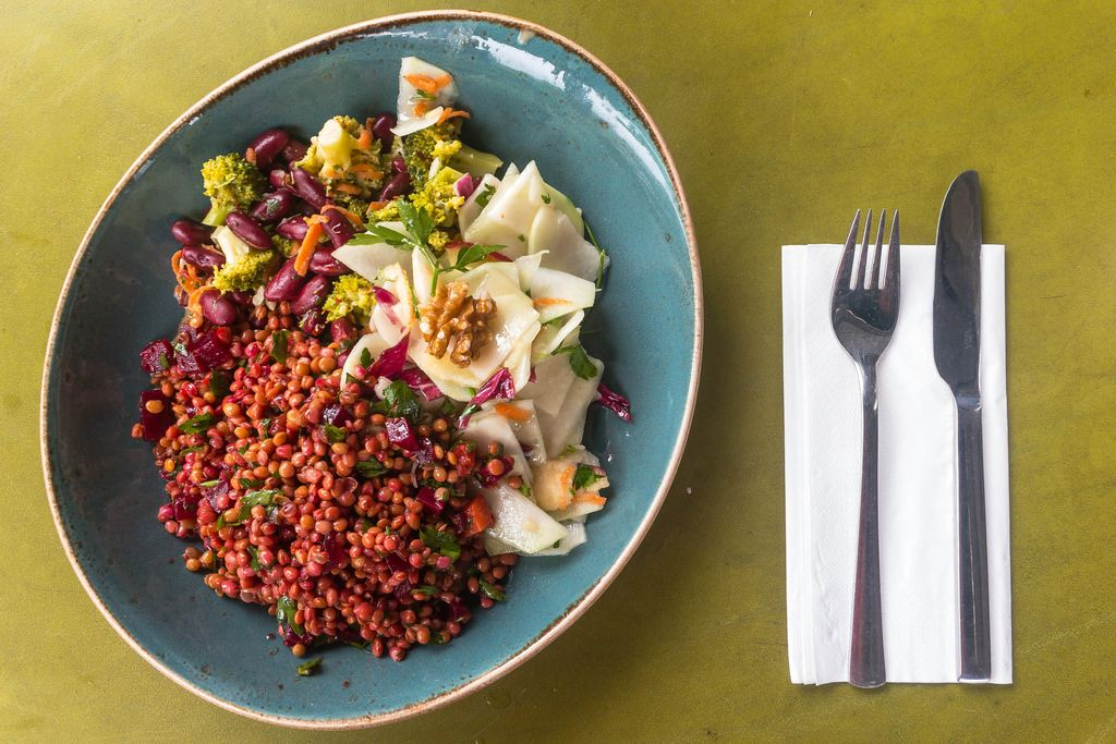 Vegan salad with red lentils, radish, broccoli and beetroot