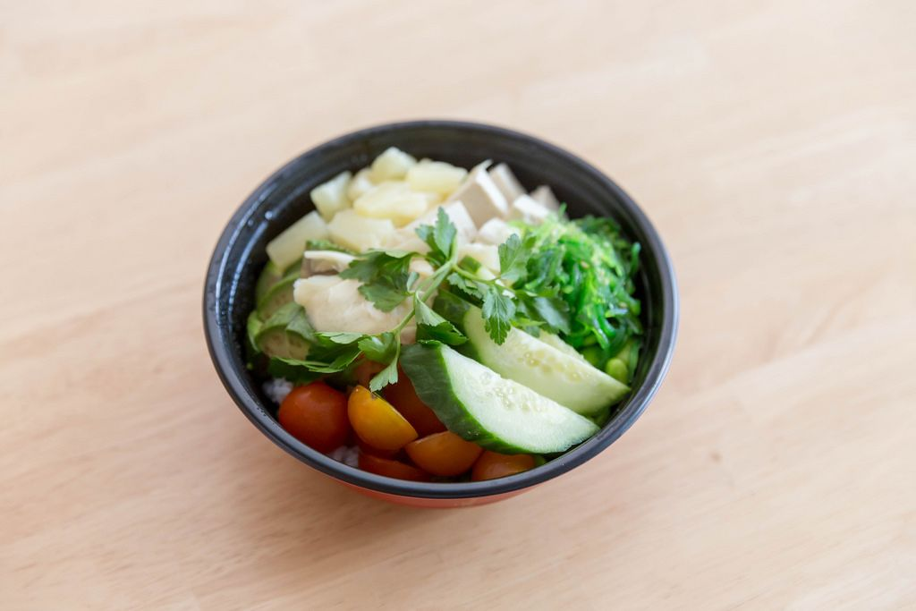 Veggie Bowl with tofu, pineapple and various vegetables  - close up