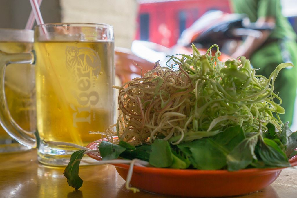 Vietnamese Herbs with Iced Tea at a local Streetfood Vendor in Saigon