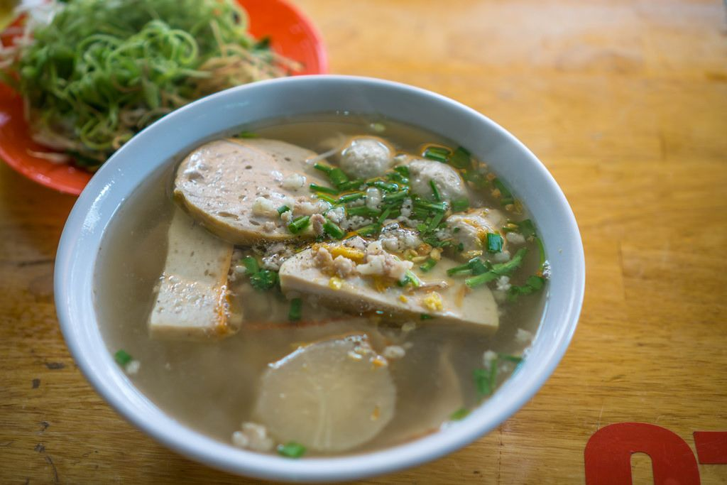 Vietnamese Noodle Soup with Herbs in the Background