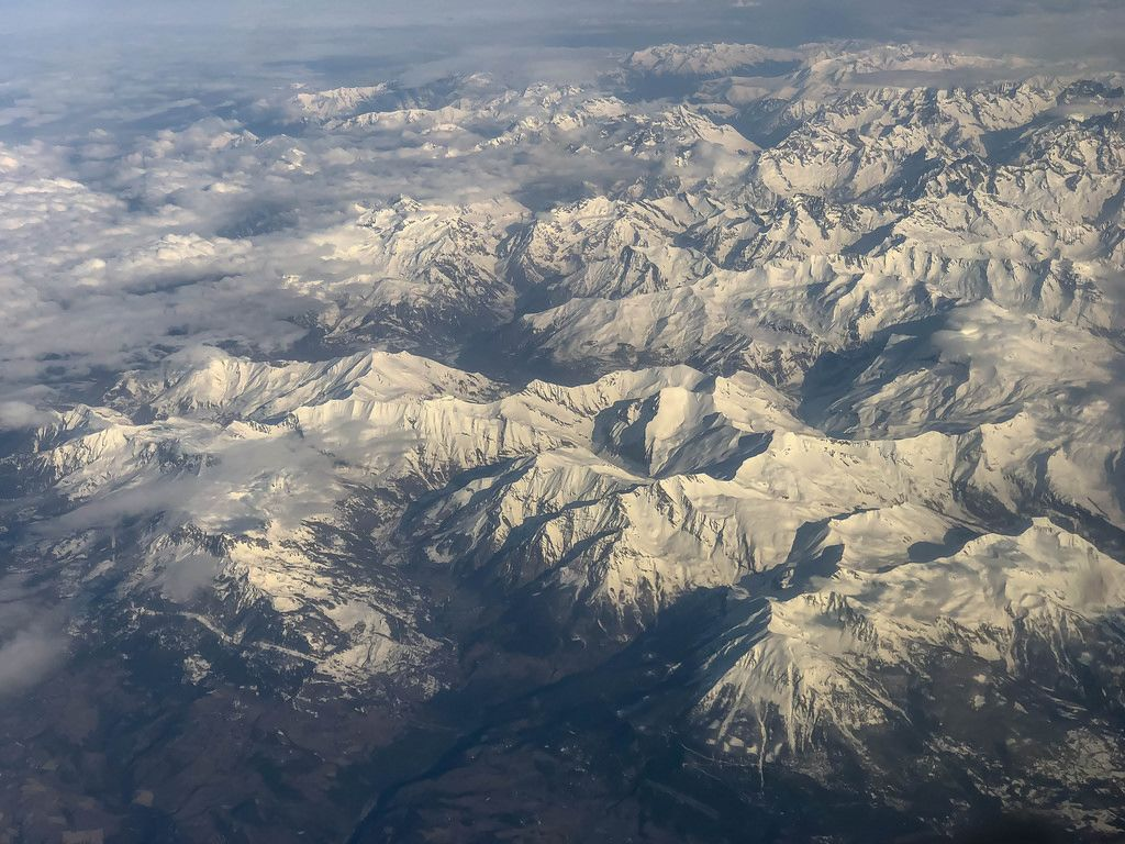 View at the Alps through an air plane window