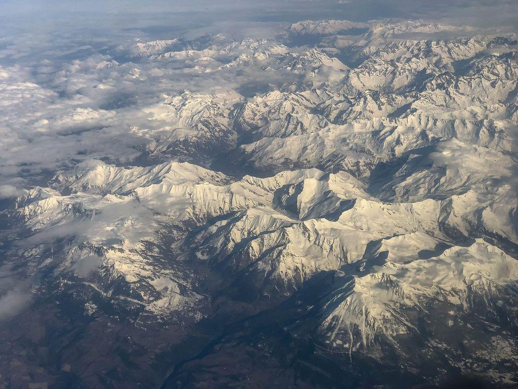 View at the Alps through an air plane window