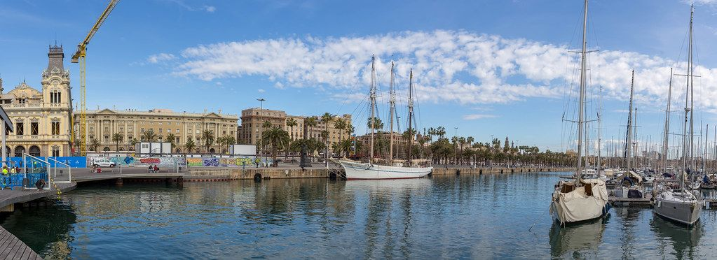 View from the wooden walkway of Rambla de Mar to the Port Vell  with its sailboats and yachts in Barcelona, on the east coast of Spain.