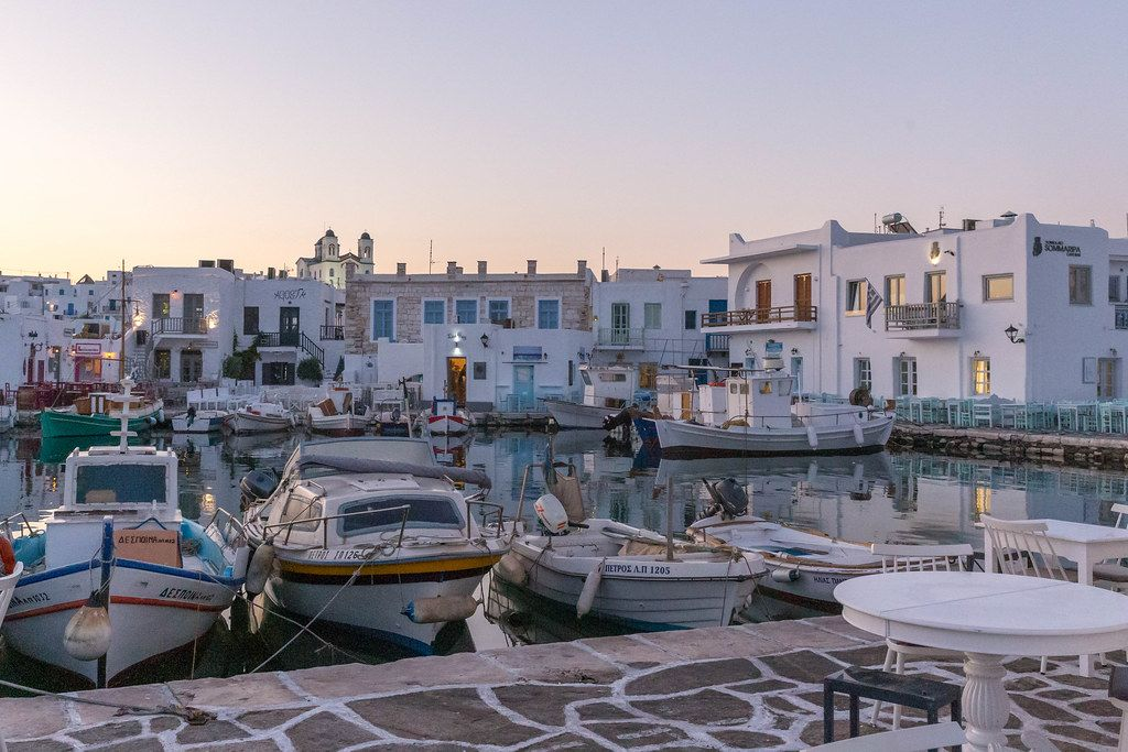 View of a harbour in front of the Greek village Limanaki-Naousa on Paros
