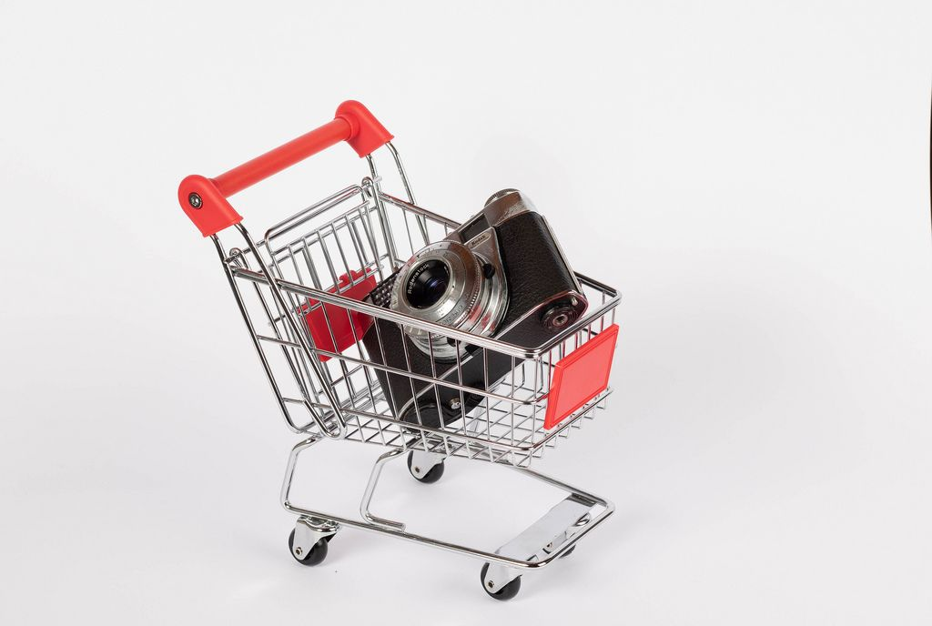 Vintage camera in shopping cart