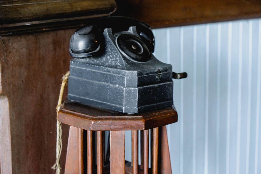 Vintage telephone on wooden stool