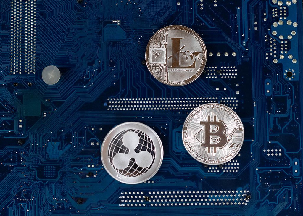 Virtual symbols of the coin Bitcoin, Litecoin and Ripple