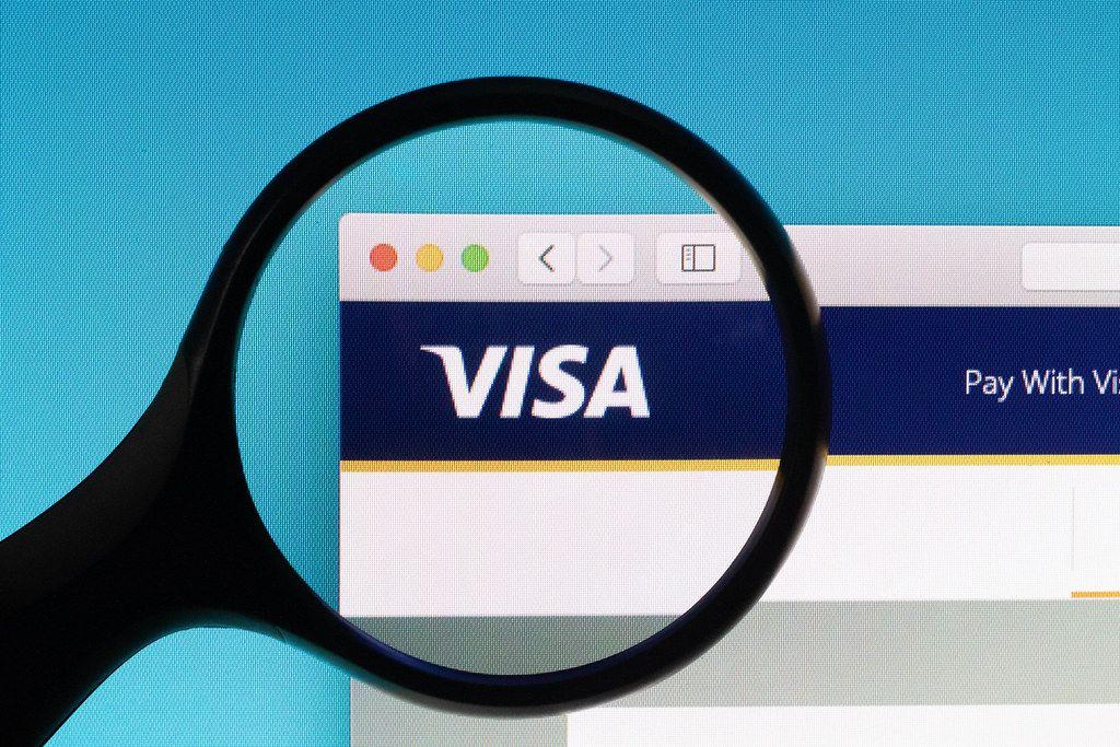 Visa logo under magnifying glass