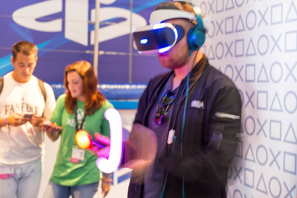 Visitor waving about the PlayStation Move controllers (PS4 VR) - Gamescom 2017, Cologne