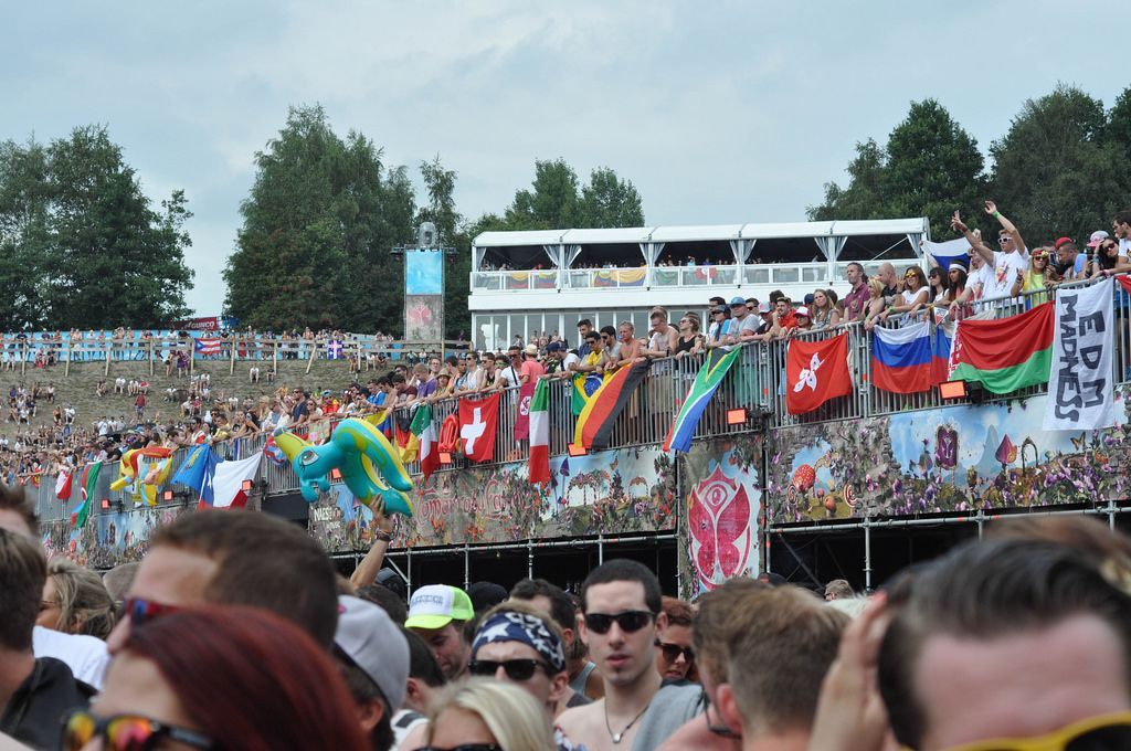 Visitors and flags in the background - Tomorrowland music festival 2014
