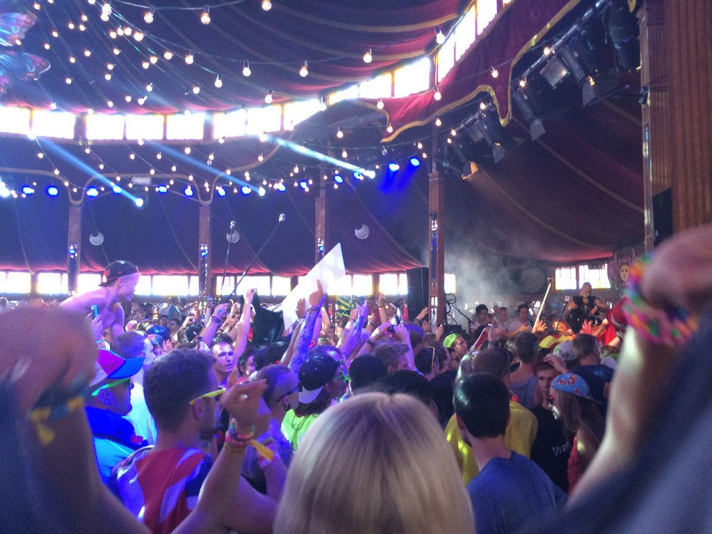 Visitors dancing indoors - Tomorrowland music festival 2014