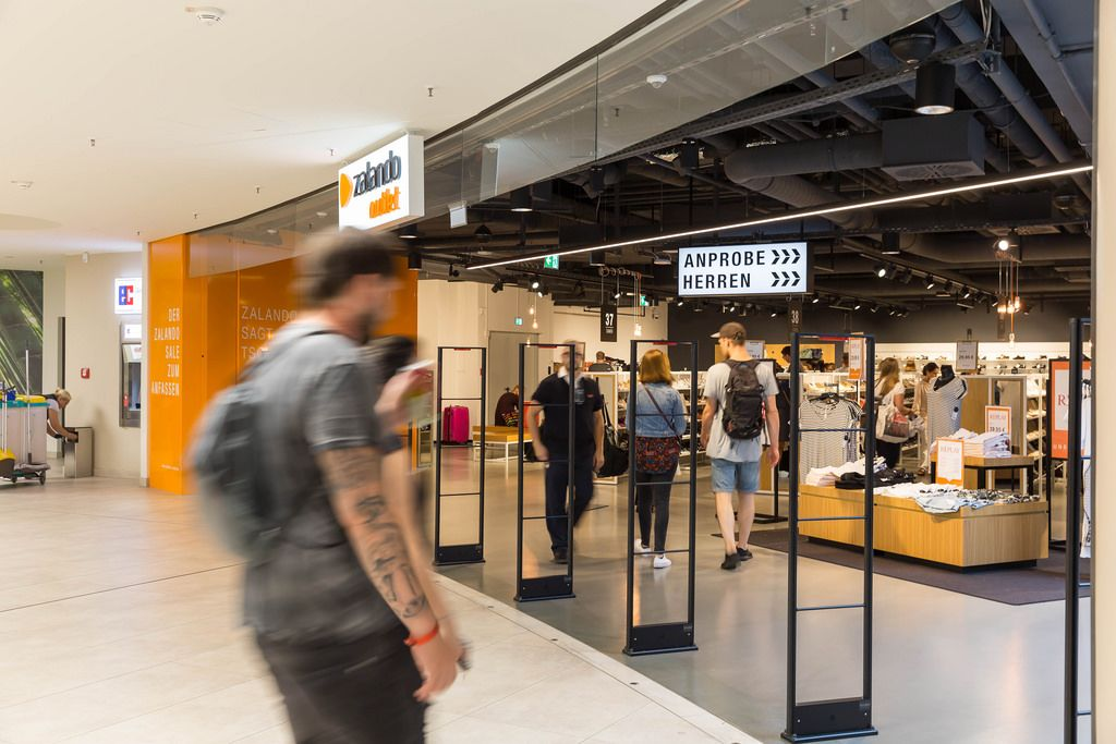 Visitors entering a Zalando store