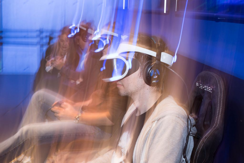Visitors gaming with PlayStation VR headsets - Gamescom 2017, Cologne