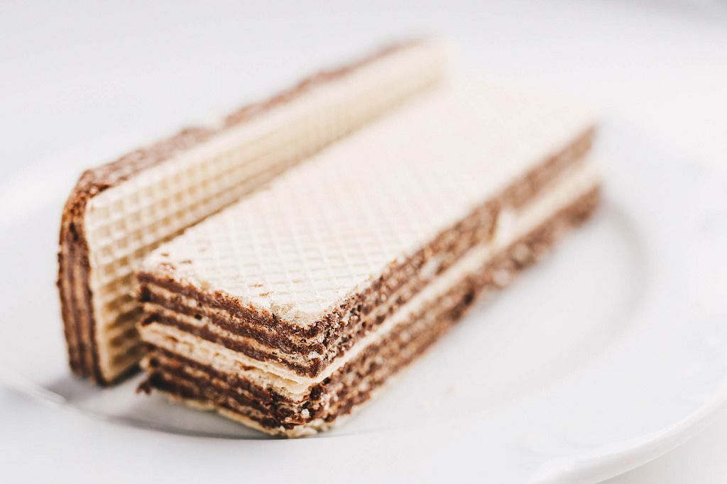 Waffles with chocolate filling on white background. Close up
