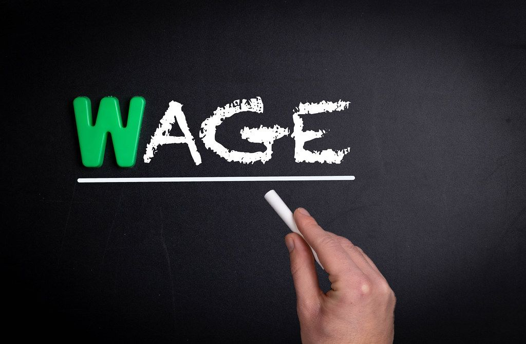 Wage text on blackboard