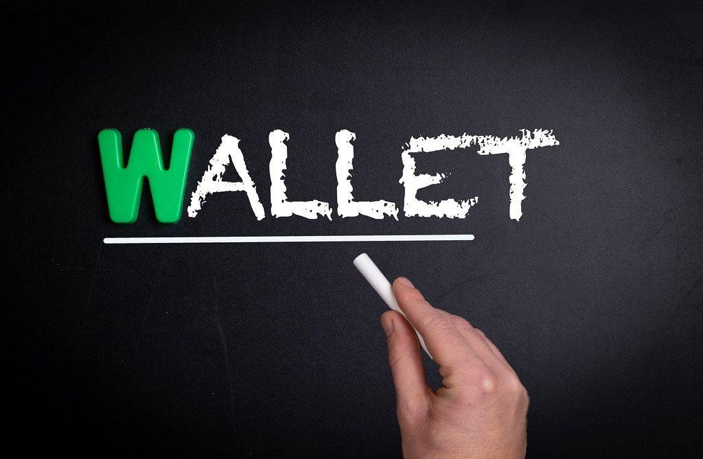Wallet text on blackboard