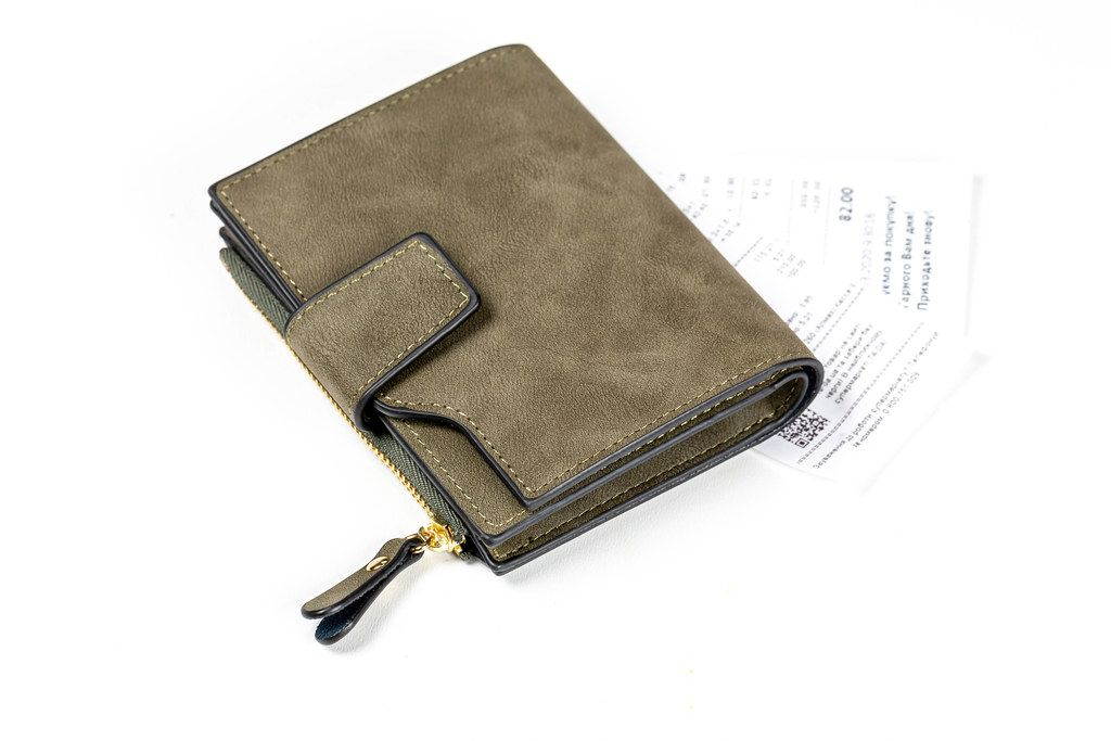 Wallet with receipts on a white background. Concept of monetary expenses, payment
