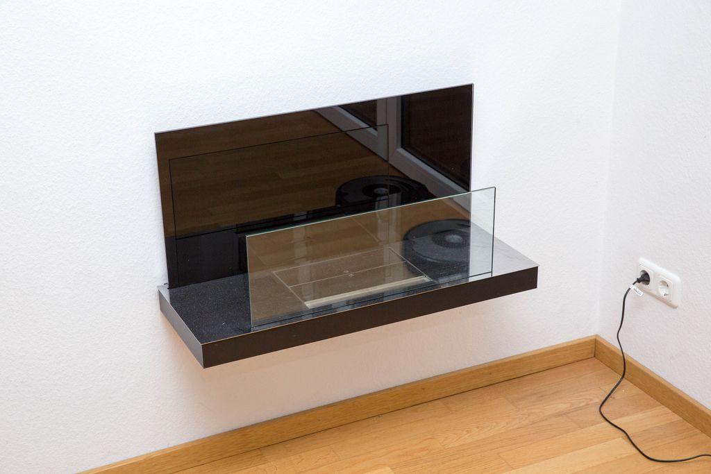 Wandmöbelstück aus schwarzem Granit und Glas