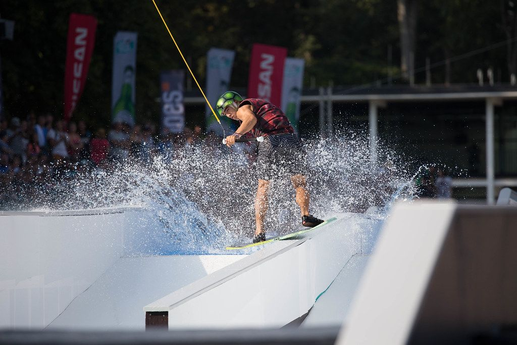 Water skiing man in front of audience