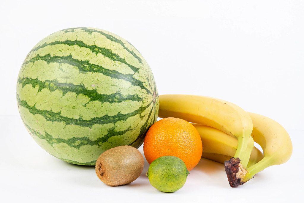 Watermelon Bananas Orange Kiwi and Lime on the white background