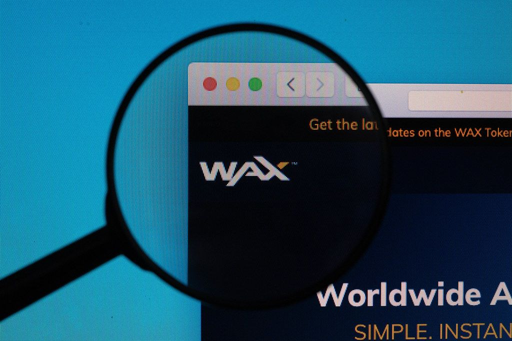 Wax logo under magnifying glass