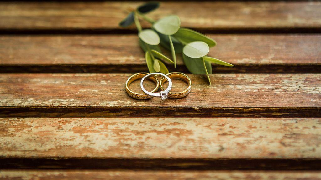 Wedding rings on a wooden table (Flip 2019) (Flip 2019) Flip 2019