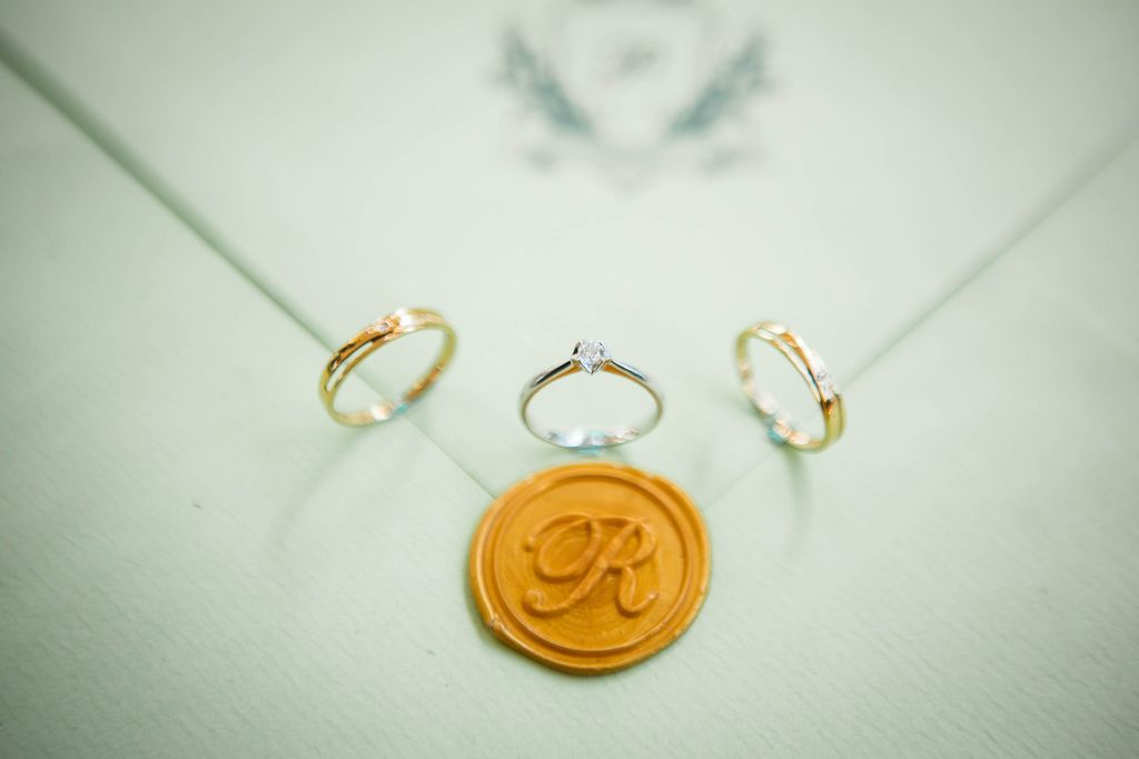 Wedding rings on an invitation stamp