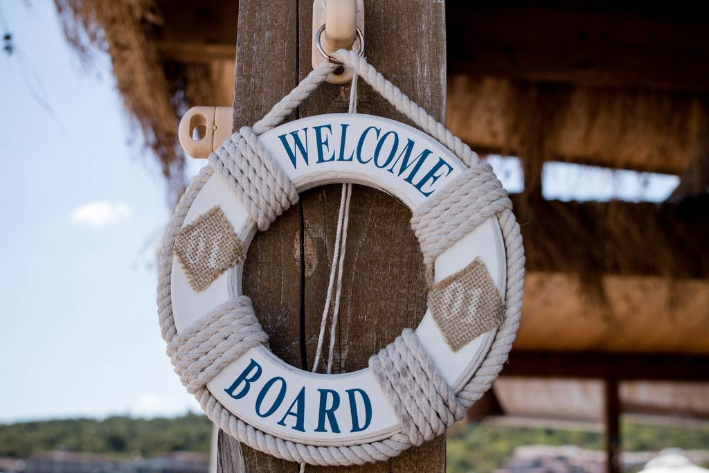 Welcome a board sign on rustic wood, beach bar
