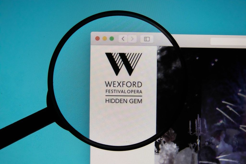 Wexford Festival Opera logo on a computer screen with a magnifying glass