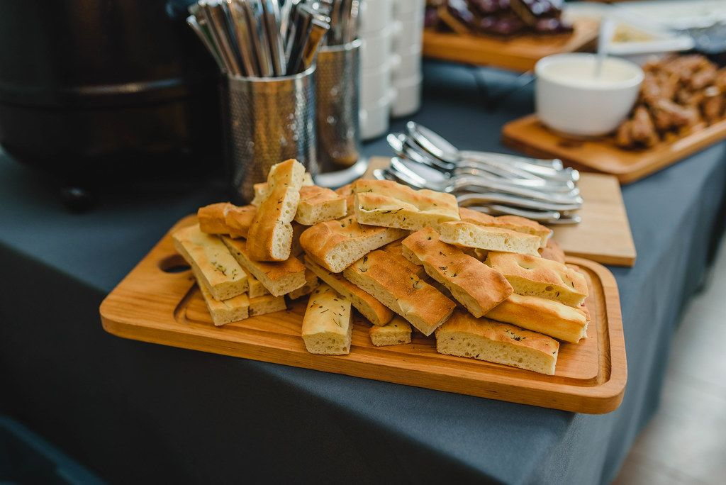 White Bread Slices On A Wooden Board