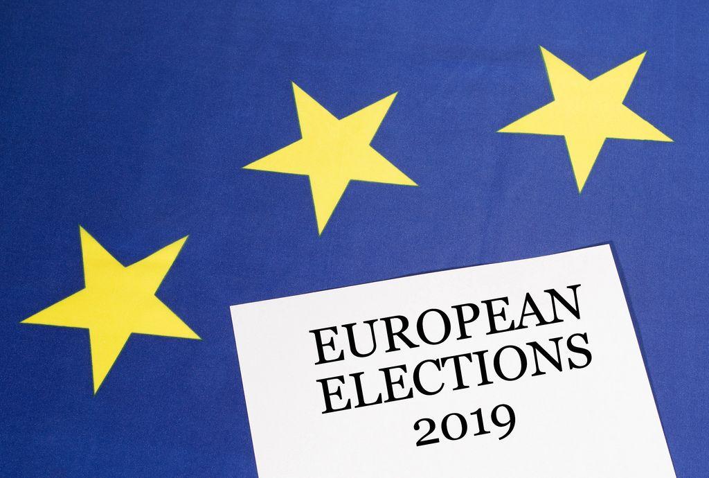 White paper with European elections 2019 text on European Union flag