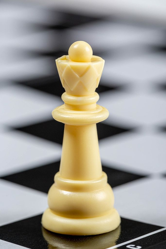 White Queen on the background of an empty chessboard