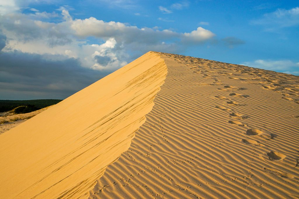 White Sand Dunes in Mui Ne with Sunset Reflection