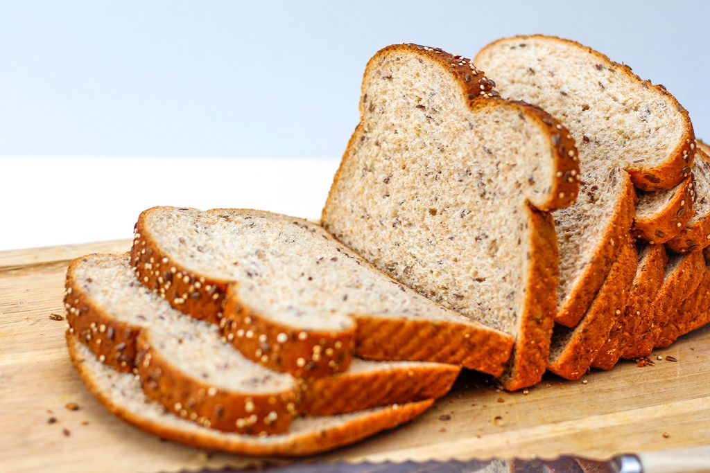 Whole Bread on a Cutting Board