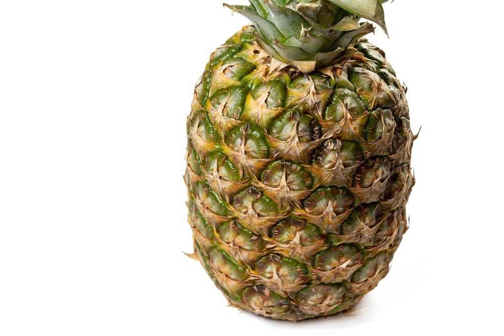 Whole Pineapple on the white background with copy space