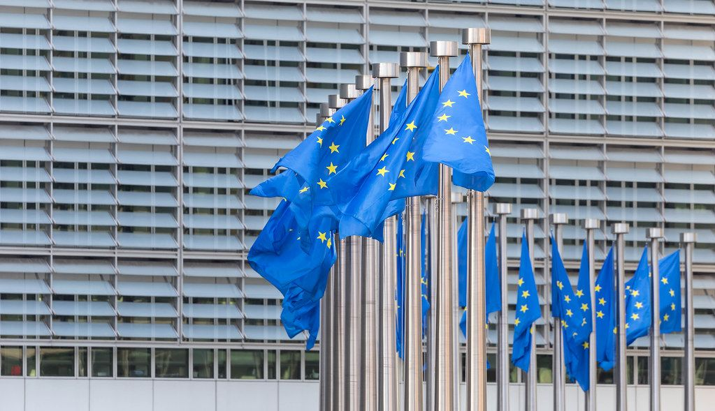 Wind blows the flags of the European Union in front of the Berlaymont Building in Brussels, Belgium