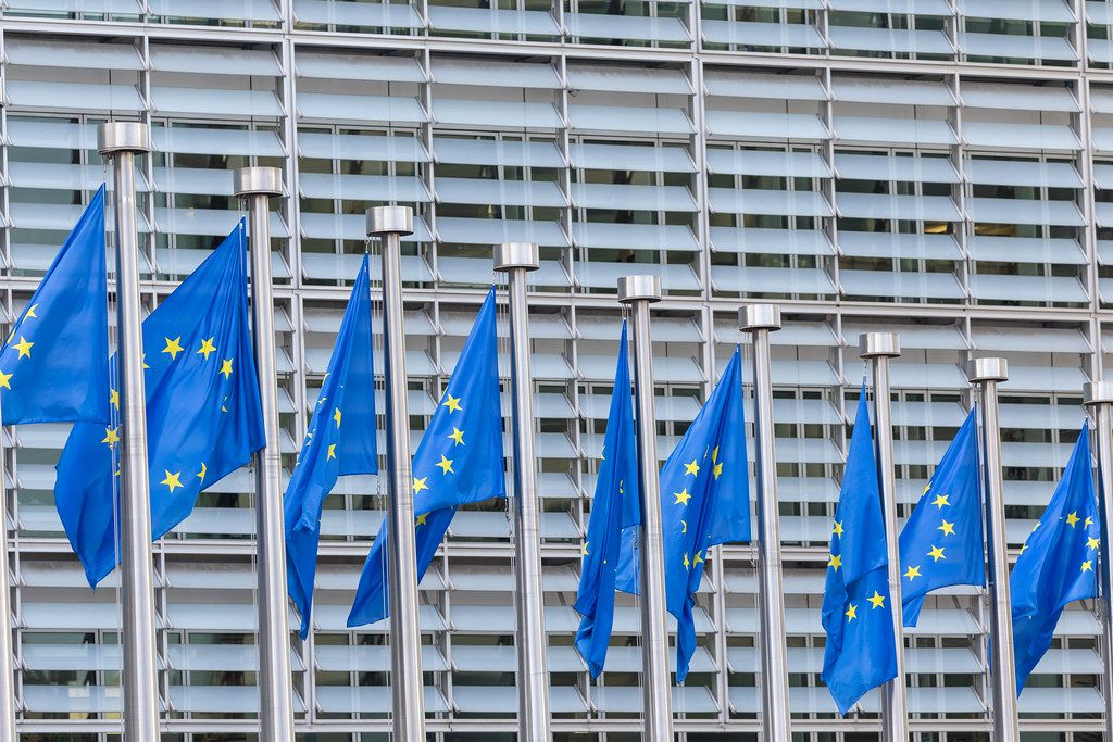 Wind blows the flags of the European Union in the headquarter of the European Committee in Brussels