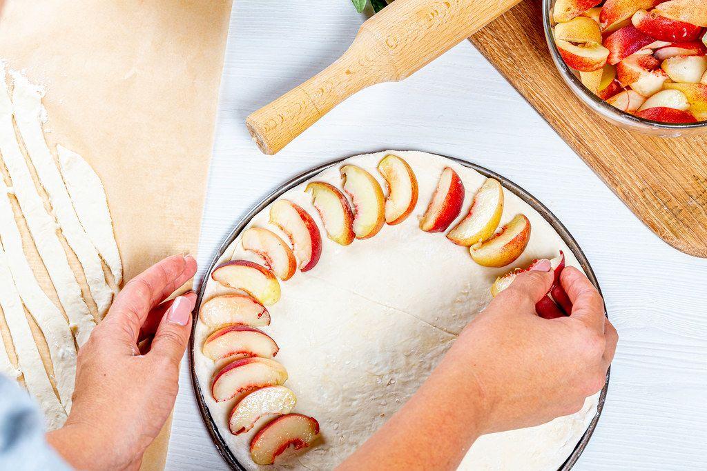 Woman-preparing-homemade-peach-pie.jpg