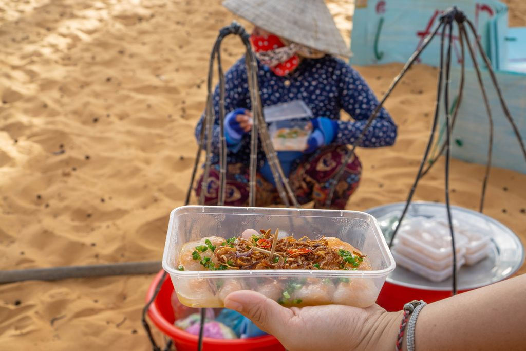 Woman selling Food at the Entrance of the Red Sand Dunes in Mui Ne