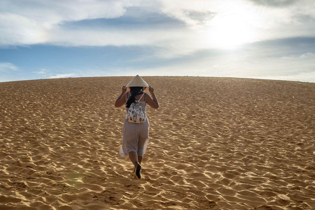 Woman with Vietnamese Hat in the Red Sand Dunes in Mui Ne, Vietnam (Flip 2019) (Flip 2019) Flip 2019