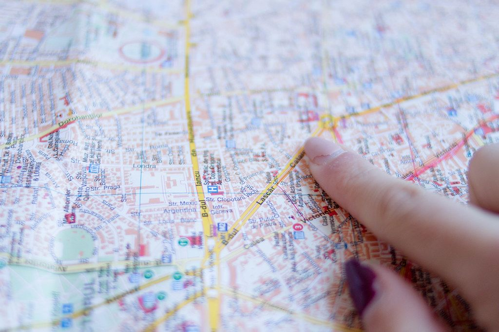 Woman's finger pointing at Bucharest City Map