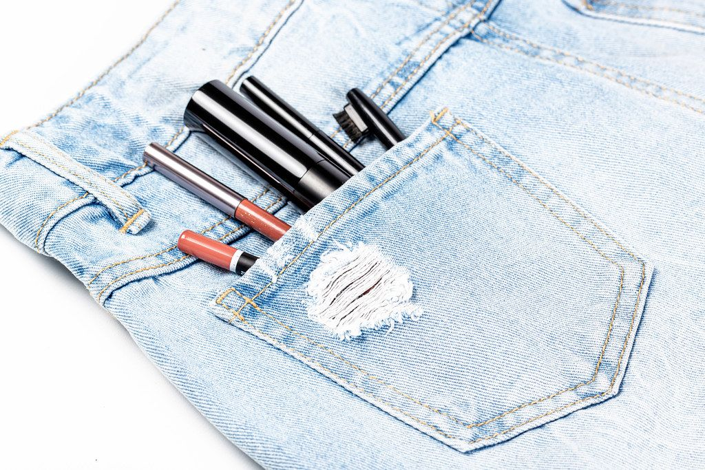 Women's cosmetics in the pocket of jeans