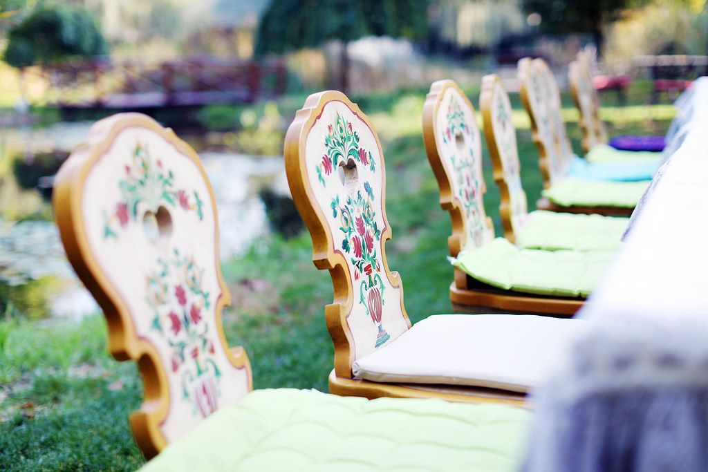 Wooden chairs with traditional motifs, closeup view (Flip 2019)