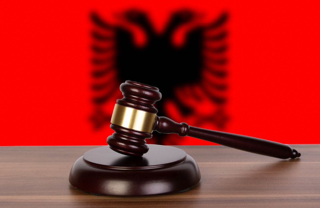 Wooden gavel and flag of Albania