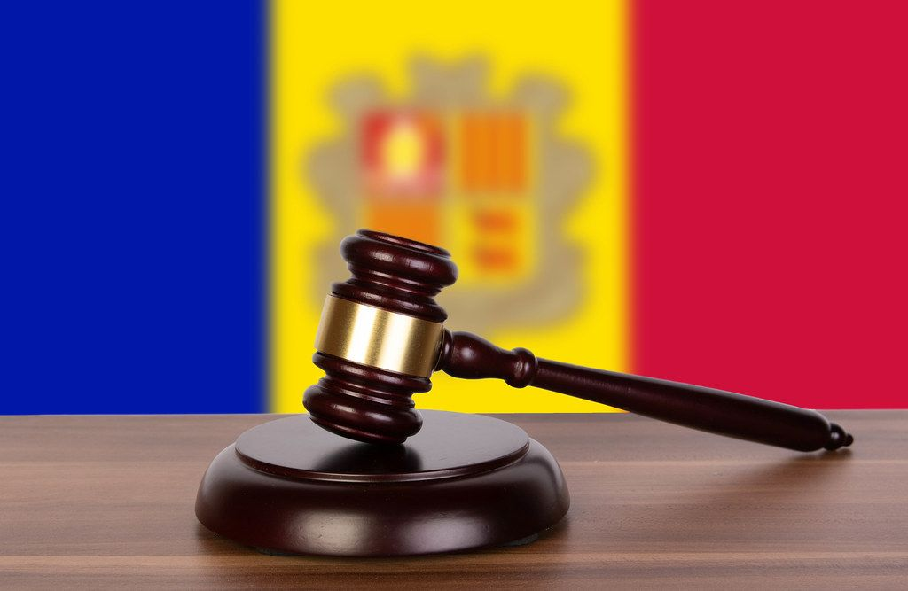 Wooden gavel and flag of Andorra
