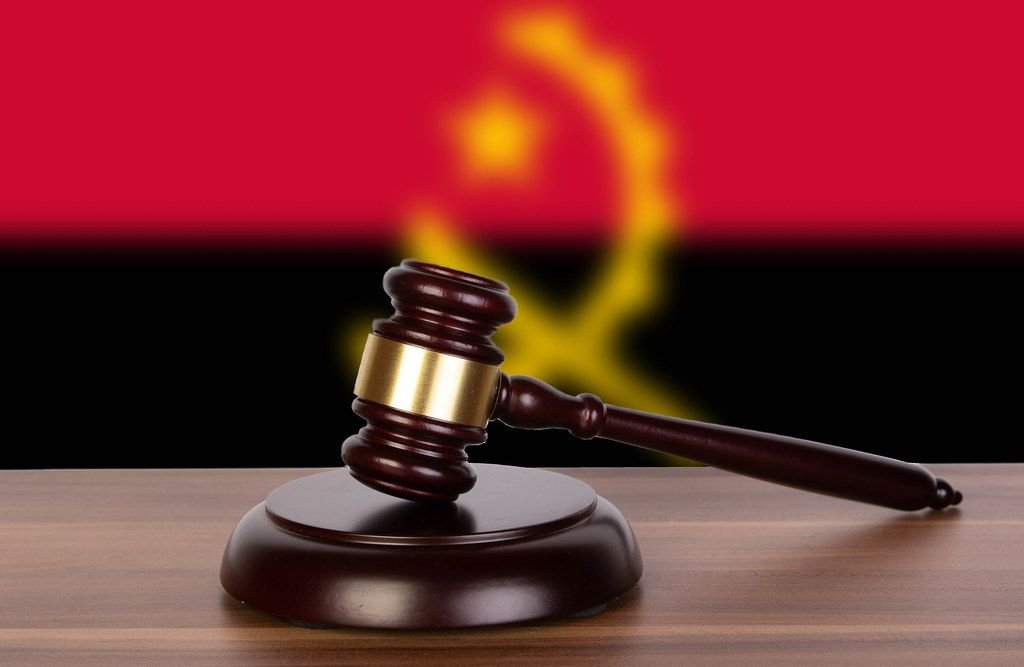Wooden gavel and flag of Angola