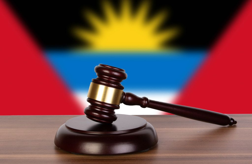 Wooden gavel and flag of Antigua and Barbuda