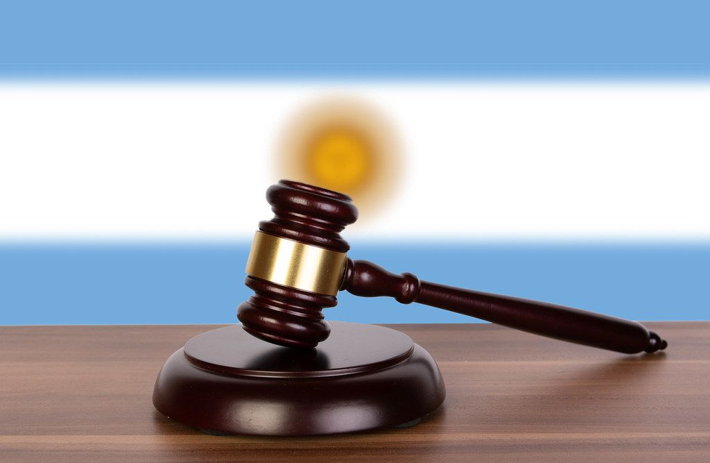 Wooden gavel and flag of Argentina