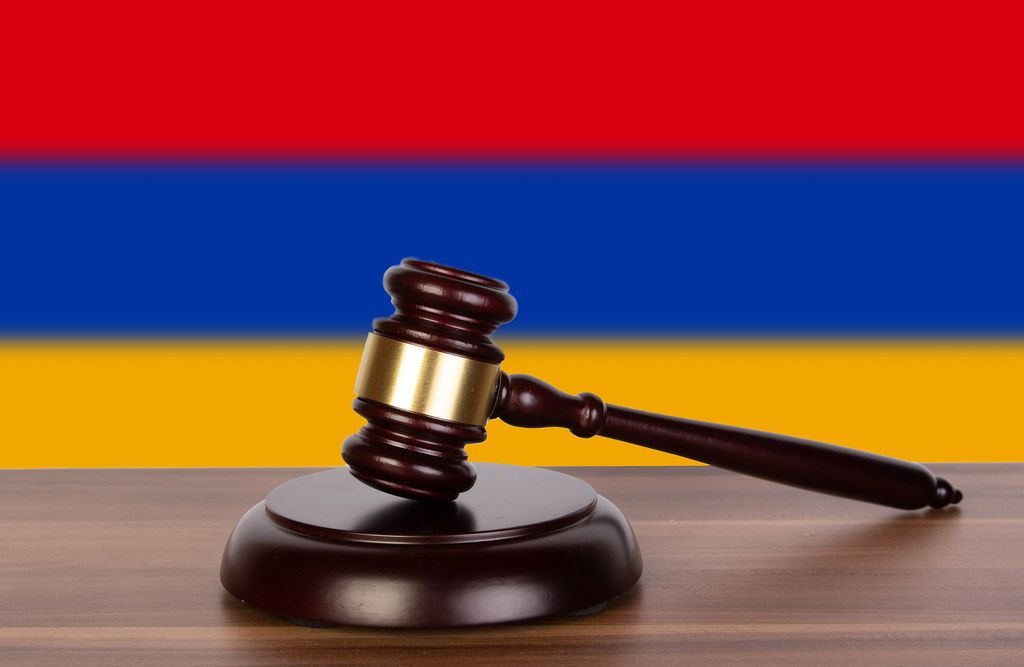 Wooden gavel and flag of Armenia